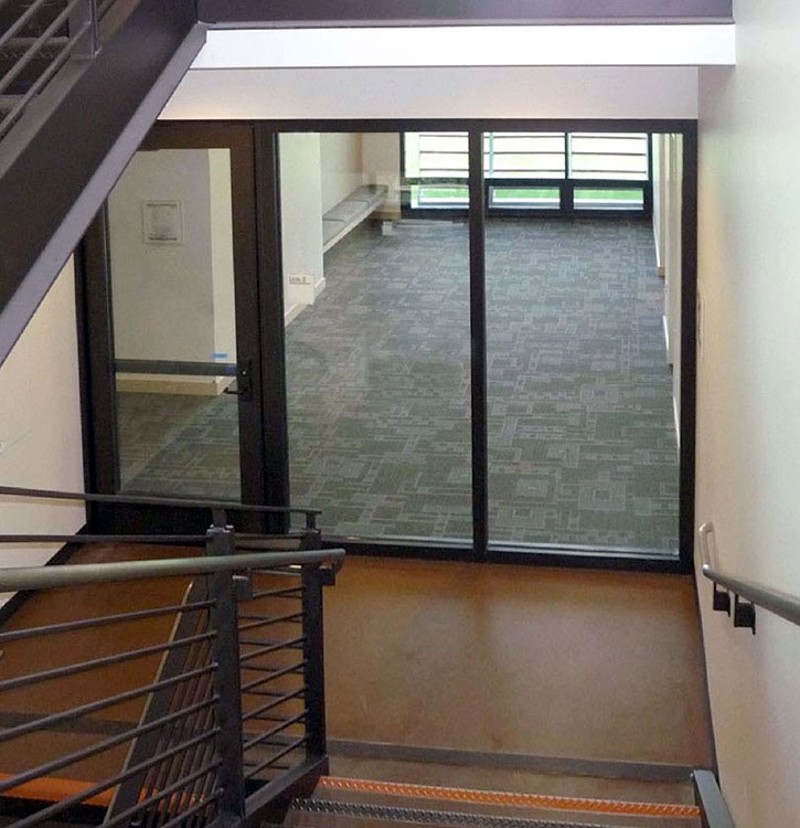A 2 hour exit enclosure with 90 minute doors. Fire resistive glass is used to bring vision and transparency to the 2 hour exit enclosure/stairwell.