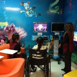 10-year old Eliyana, a patient at the Burn Center, playing with one of the Starlight® Fun Center® mobile entertainment units donated by SAFTI FIRST to provide entertainment to children receiving treatment at the Community Medical Center in Fresno, CA