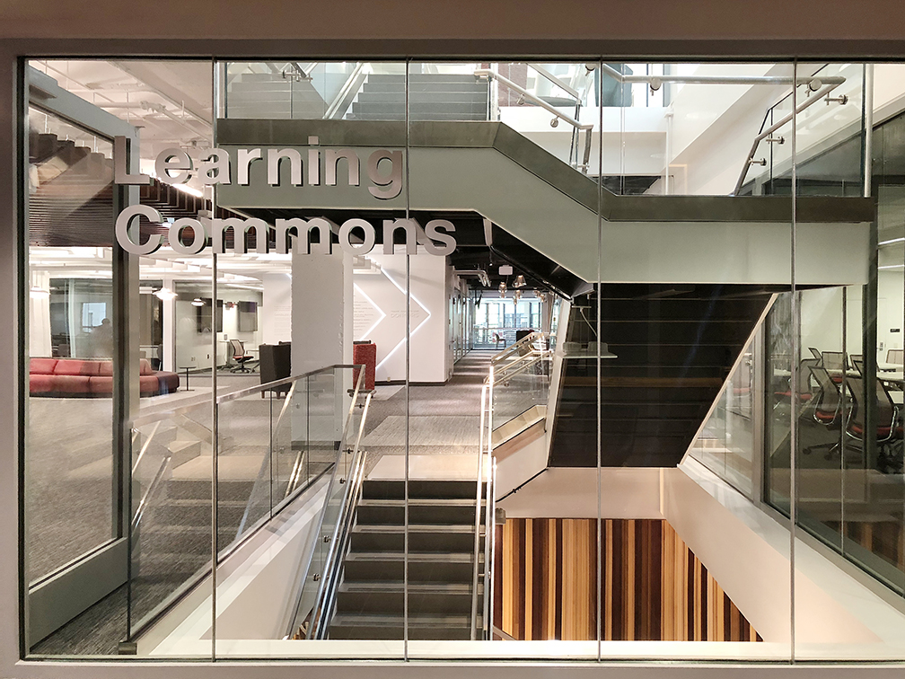 Fire Resistive Butt-Glazed Walls Create Transparent, Connected and Code-compliant Stairwell